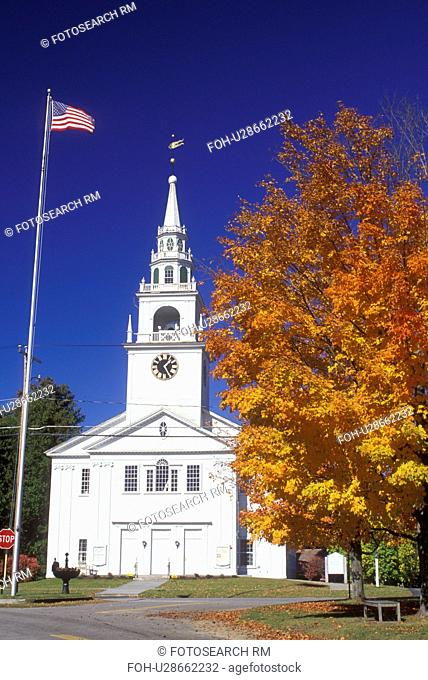 white church, Hancock, NH, New Hampshire, The American Flag flies outside the First Congregational Church in the town of Hancock in the autumn