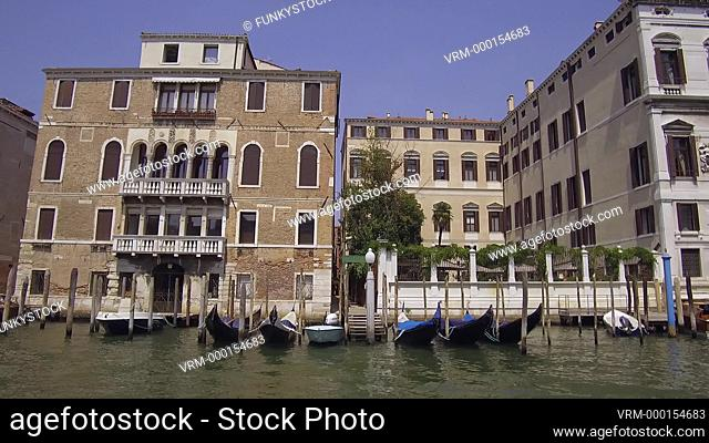Tracking moving shot along the upper Grand Canal showing Venetian Palaces, Venice, Italy