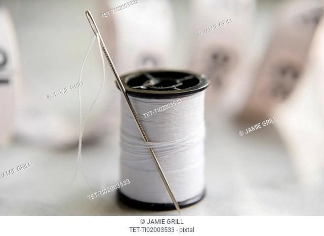 White thread and needle