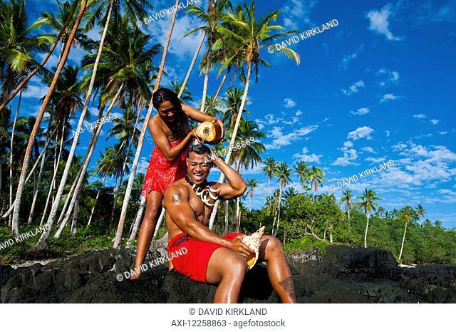 Two Samoan's playing around on South coast of Savaii; Savaii Island, Samoa
