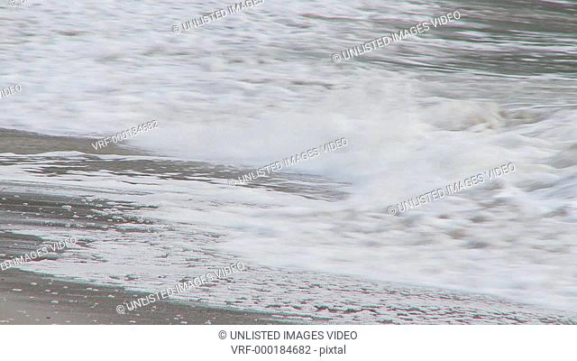 Waves breaking on shoreline