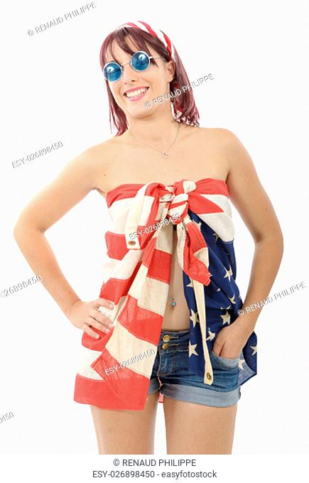 beautiful young woman dressed with american flag, on white