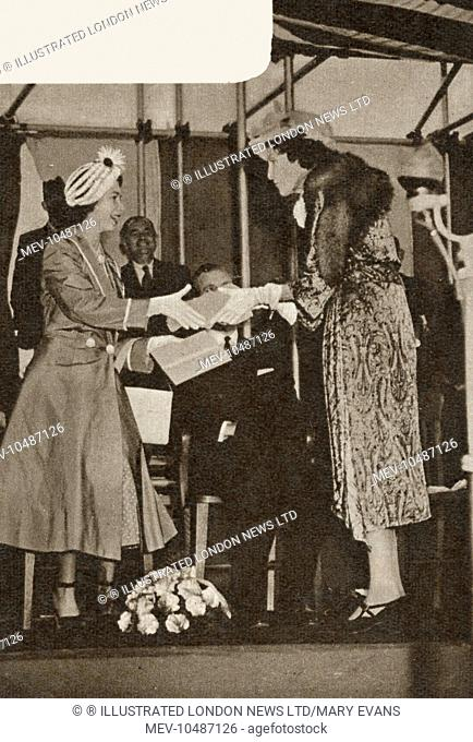 Princess Elizabeth accepting a casket from Winifred Duchess of Portland after laying the foundation stone of the main building of the Portland Training College...
