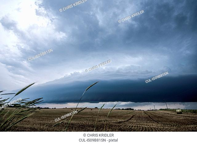 Layered supercell storm over and around wheat fields, Fairview, Oklahoma, USA