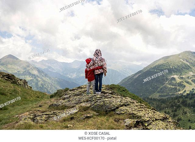 Andorra, Ordino, young girl and her brother, arm around, standing on viewpoint in the mountain