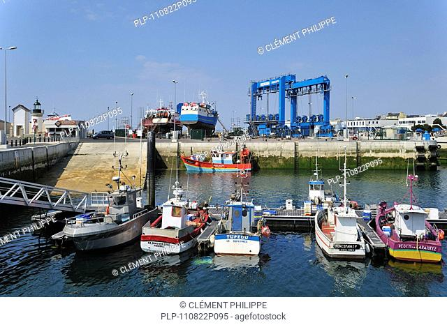 Trawler fishing boats on shipbuilding yard for maintenance works in the Guilvinec port, Brittany, France