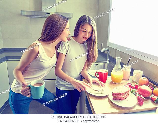 best friends girls teens breakfast in kitchen having fun