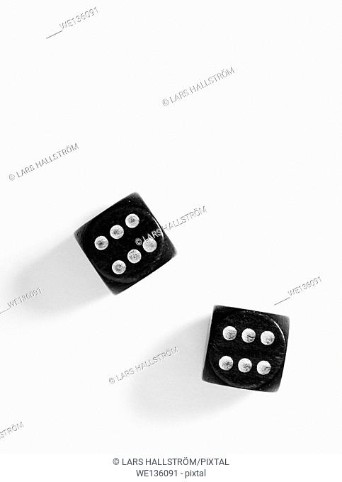 Top view of a pair of black dice on white background with copy space. Double sixes