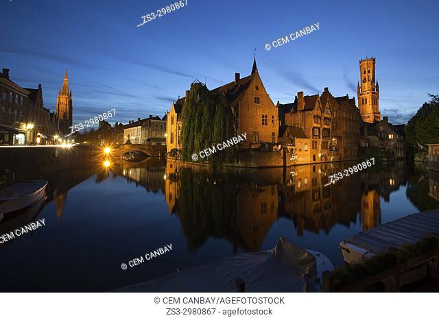 View to the Rozenhoedkaai, Canal,Tower and Church Of Our Lady Of Bruges by night, Bruges, West Flanders, Belgium, Europe