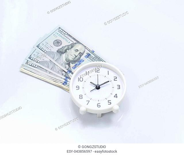 Money and time; clock and US dollar banknote
