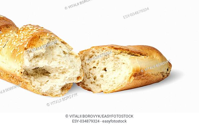 Two fresh French baguette piece isolated on white background
