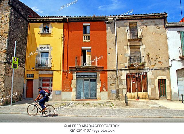 Houses and cyclist, Sarrià de Ter, Girona, Catalonia, Spain