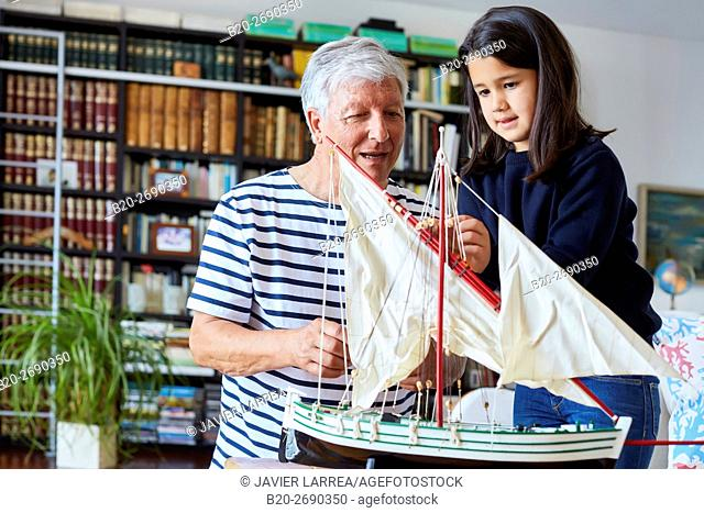 Grandfather and granddaughter, Building model sailboat, Whaleship, Getaria, Gipuzkoa, Basque Country, Spain, Europe