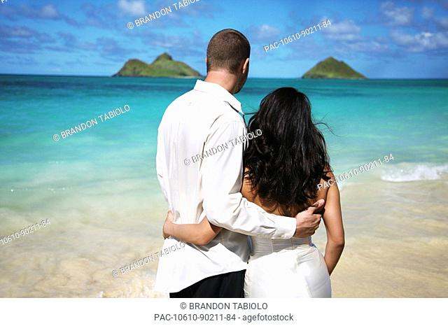 Oahu, Hawaii, Lanikai, Young couple both holding eachother