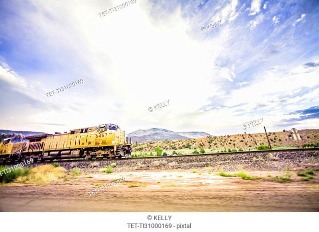 Train on railroad tracks in countryside