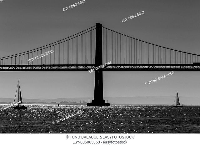 San Francisco Bay bridge sailboat from Pier 7 in California USA