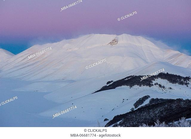 Mount Vettore at sunset in winter with snow, blue and pink sky, Sibillini mountains NP, Umbria, Italy