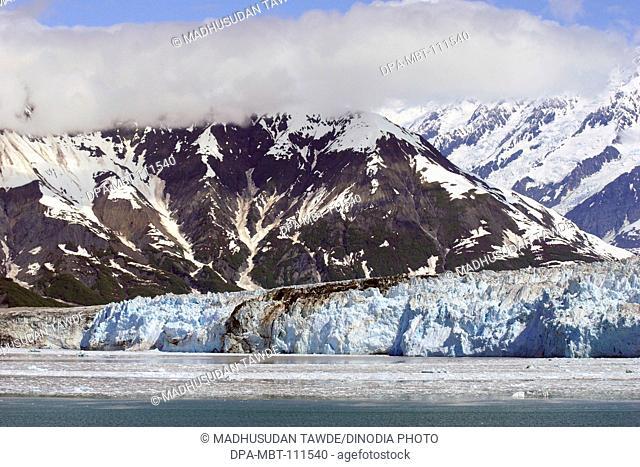 Icebergs with Hubbard glacier and Saint Elias mountain; the longest tidewater glacier in Alaska; Saint Elias  national park ; disenchantment bay ; Alaska ; U