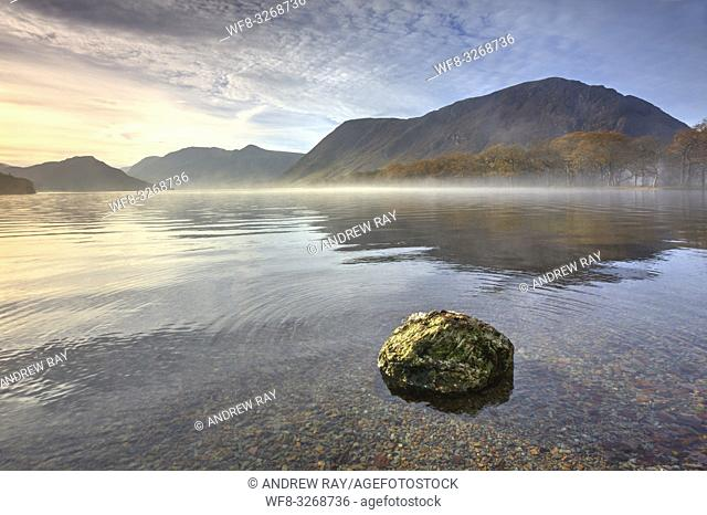 A boulder at the northern end of Crummock Water in the Lake District National Park, captured on a still misty morning in late October