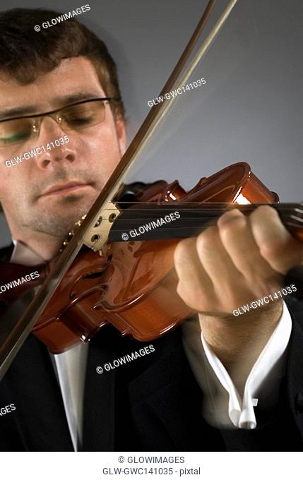 Close-up of a musician playing a violin