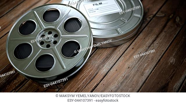 Vintage film reel with filmstrip on wood background. Video, cinema, movie, multimedia concept. 3d illustration