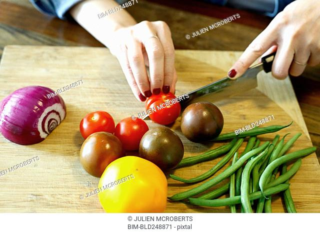 Hands of woman chopping vegetables