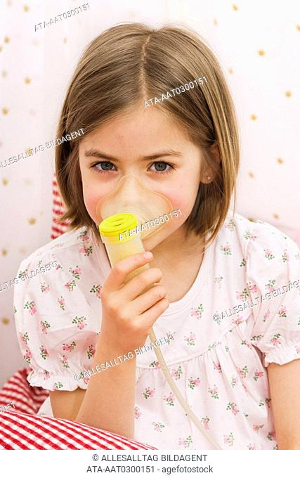 Little girl inhaling