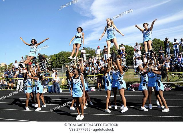 cheerleaders perform at a football game
