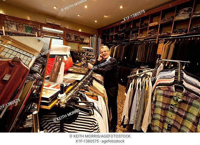 Brian John , the owner of a small independent mens clothing shop in Aberystwyth Wales UK