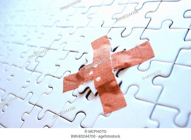 missing part of a puzzle fixed with a sticking plaster