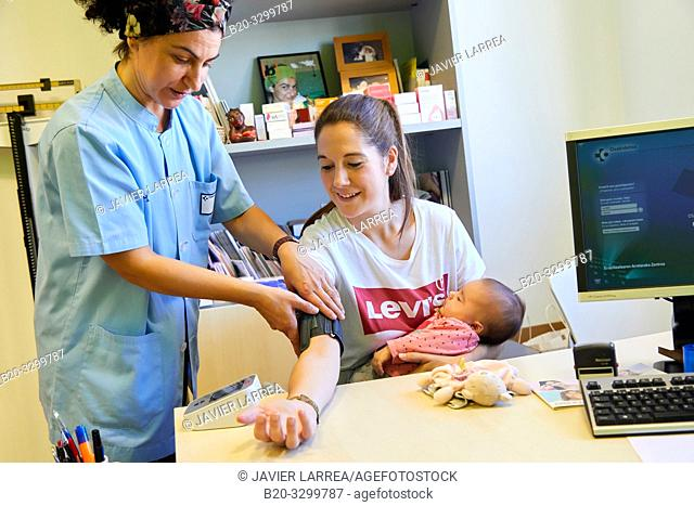 Taking blood pressure, Consultation of Matron with mother and baby, Health Center, Zarautz, Gipuzkoa, Basque Country, Spain
