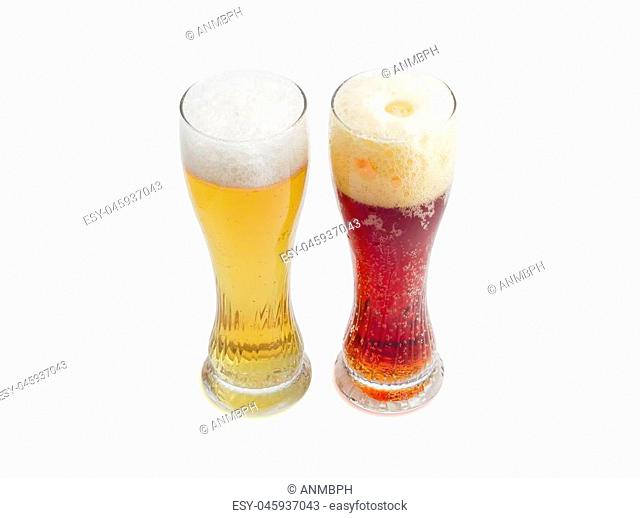 One beer glass lager beer and one beer glass dark beer with foam on a light background
