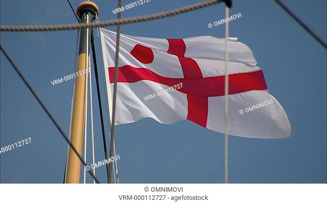 St. George's Cross flag flying from ship's flagpole