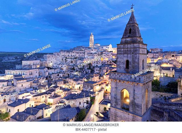 View of Church of San Pietro Barisano and Sasso Barisano historic centre with cathedral at dusk, Matera, Basilicata, Apulia, Italy