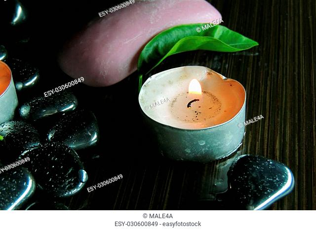 Zen stones and aromatic candles on table,Zen concept