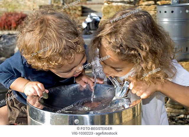 children drink water from water tap . - 09/10/2008