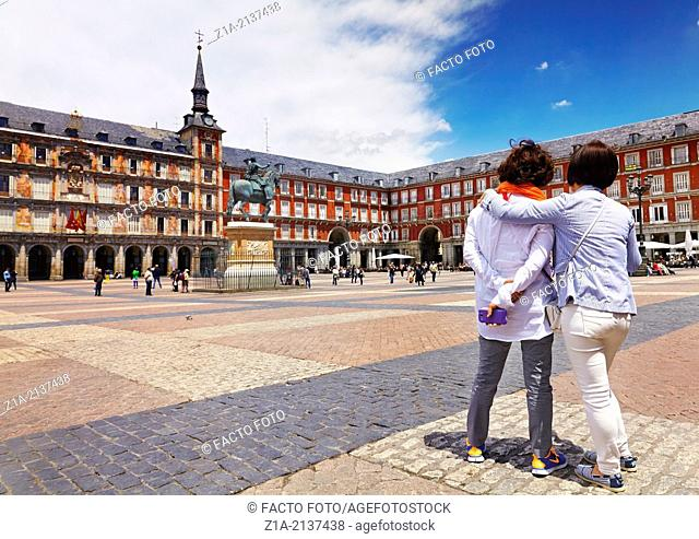 Two women sightseeing in the Plaza Mayor. Madrid. Spain