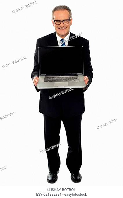 Aged businessman showing newly launched laptop