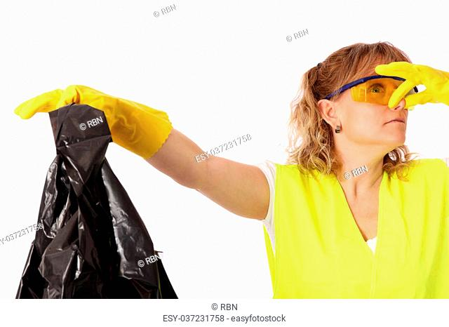 Female wearing safety clothes holding a garbage bag. White background