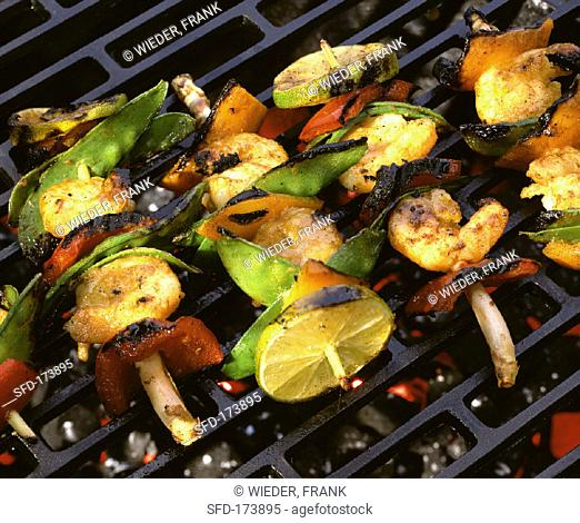 Scampi and vegetable kebabs on grill
