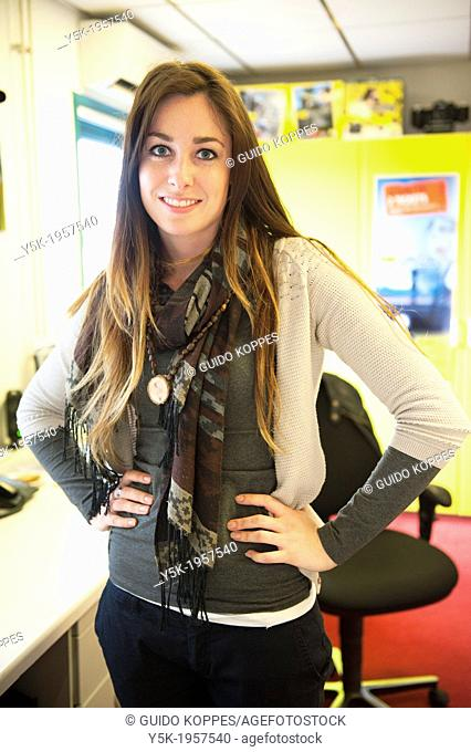 Beverwijk, Netherlands. Young brunette, working at a repair and service-centre for professional photographers