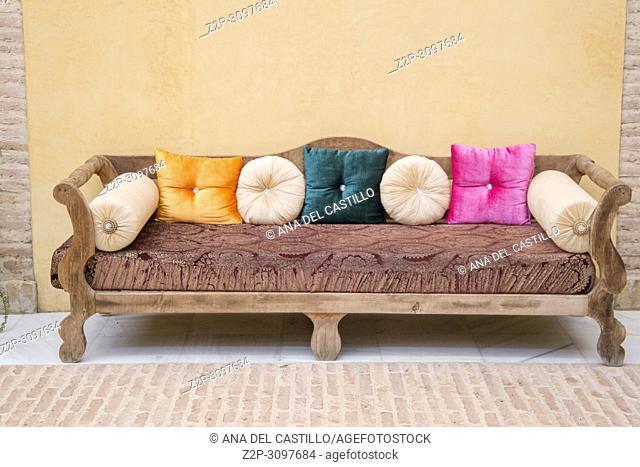 Armchair with velvet cushions