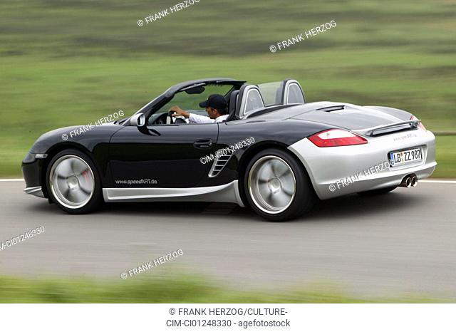 Speedart Porsche Boxster, model year 2005, black/silver, open top, driving, diagonal from the back, rear view, side view, country road, Tuning