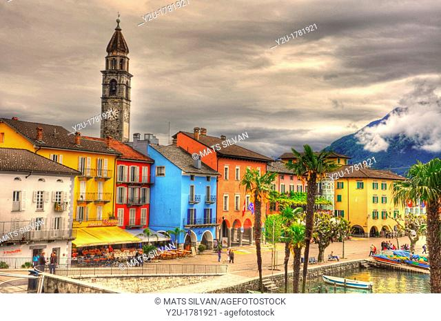 Colorful village with palm trees and mountain