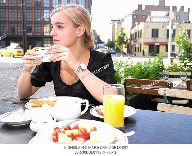 Woman having breakfast at a restaurant