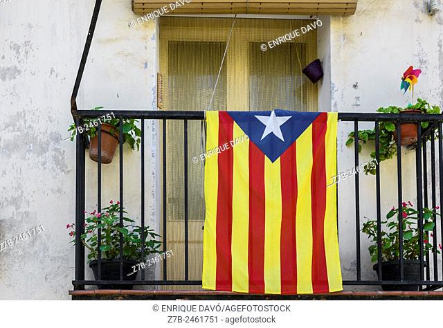 View of some flower pots with Catalonia flag in Balaguer town, Lerida province, Spain