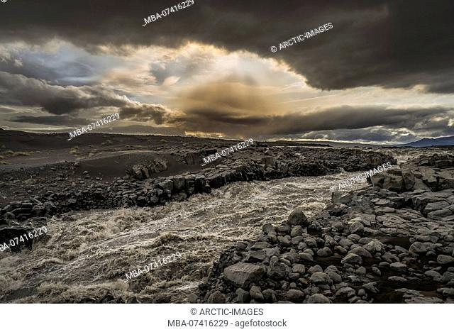 Kreppa glacial river. Background the Holuhraun Fissure Eruption by Bardarbunga Volcano, Iceland August 29, 2014 a fissure eruption started in Holuhraun at the...