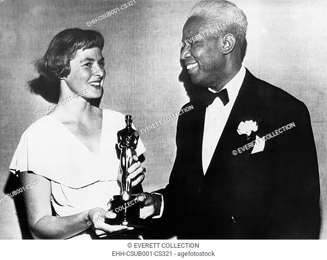 Swedish actress, Ingrid Bergman presents a special Academy Award to actor James Baskett. In March 1948 he was recognized for his role as Uncle Remus in the...