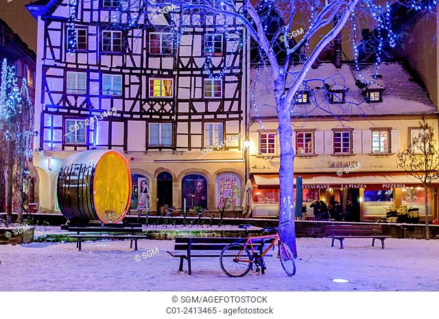 Snowy 'Place des Tripiers' square at night on Christmas time Strasbourg Alsace France