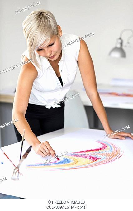 Female artist drawing